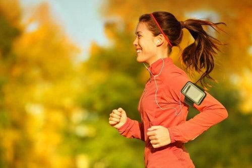 A woman jogging while listening to music.