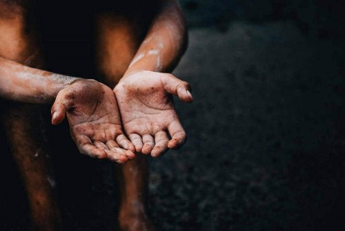 A person with dirty hands.