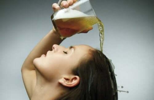 A woman rinsing her hair.