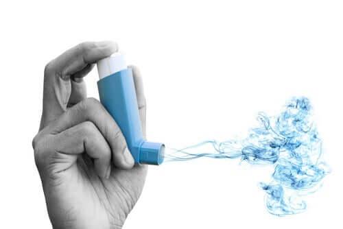 An inhaler shooting blue gas.