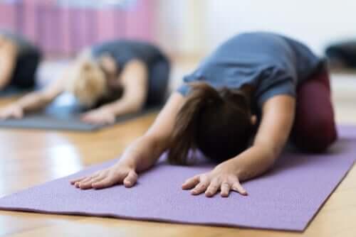 People doing yoga.