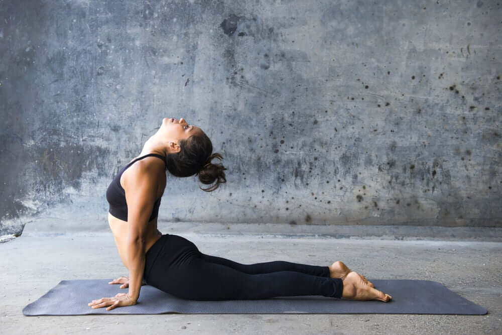 The cobra pose is one of the best yoga poses to work your abs.