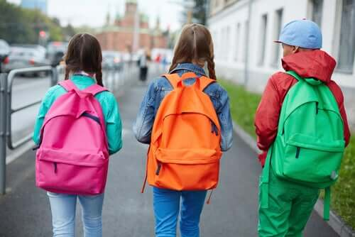 Children carrying backpacks.