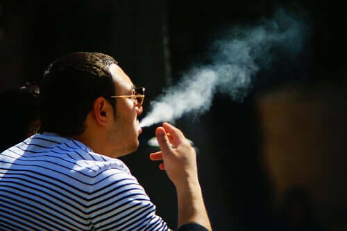 A man smoking.