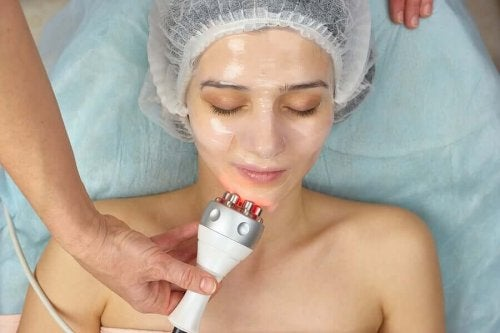 A woman getting facial RF.