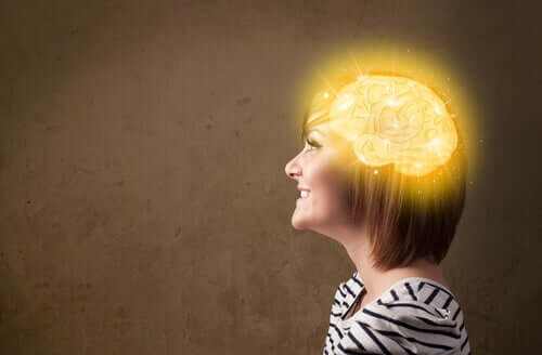 A woman with an illuminated brain.