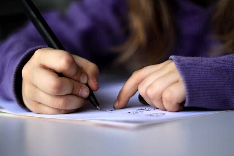 A child writing a letter.