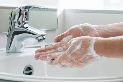 A person washing their hands.