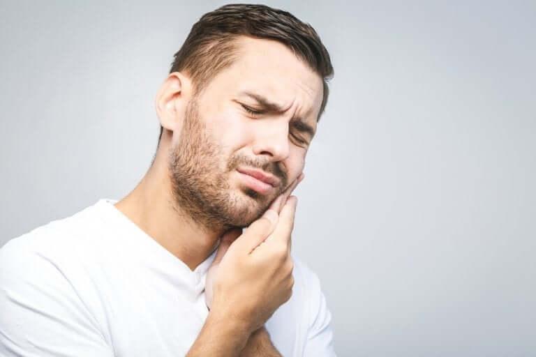 Man with wisdom teeth pain.