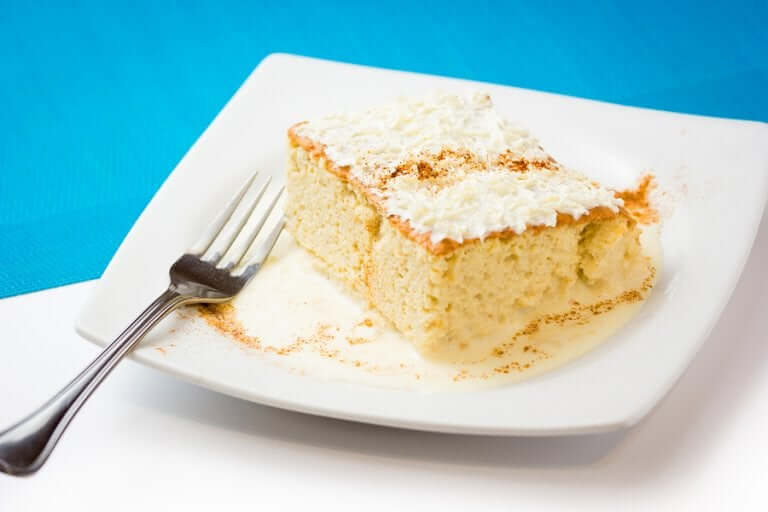Tres leches cake on a plate.