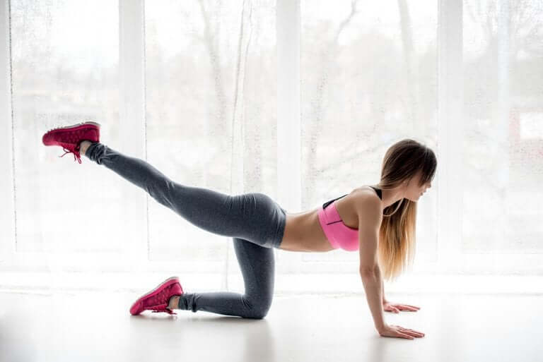 Woman doing leg lifts.