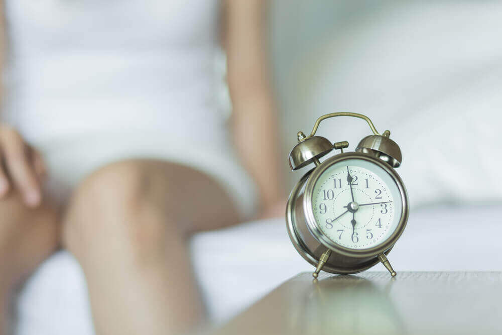 A woman and an alarm clock.