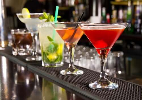 Some alcoholic drinks on a bar.