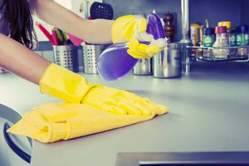 Someone cleaning surfaces.