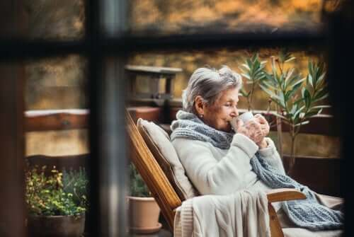 A lady drinking coffee.
