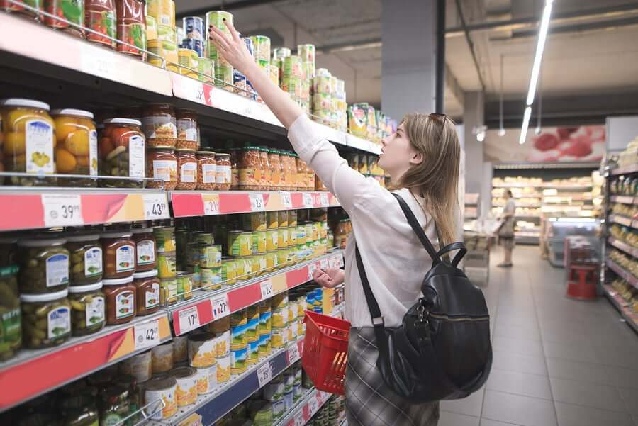 A woman grocery shopping during lockdown.