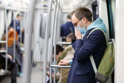 A man wearing a face mask in the subway.