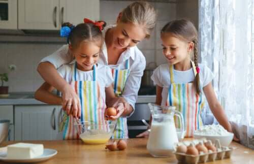 A mother baking with her daughters.