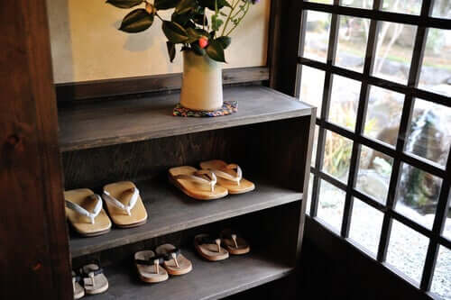 A shoerack at an entrance hall.