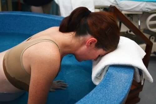 A woman dilating in a birth pool.