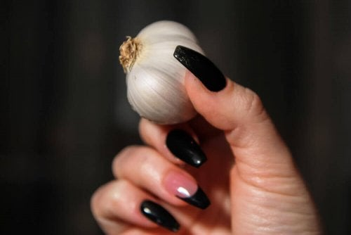 A woman holding garlic.