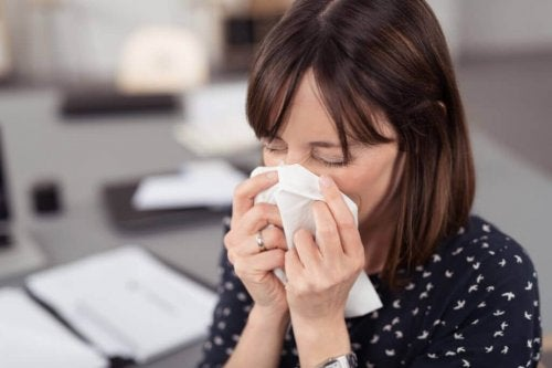 A woman with a runny nose.
