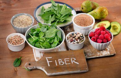 "Sources of fiber in bowls with a sign that says ""fiber""."