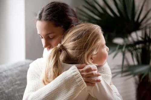 A girl hugging mom.
