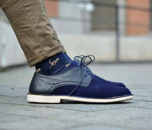A man wearing blue shoes.