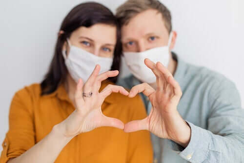 A couple wearing masks.
