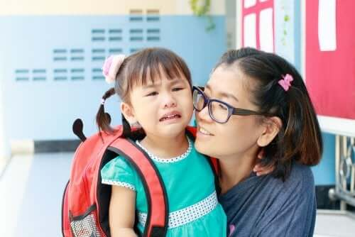 A girl crying on the first day of school.