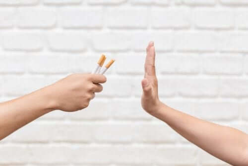 A person saying no to smoking.