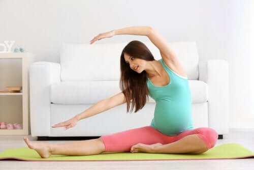A pregnant woman doing prenatal yoga.