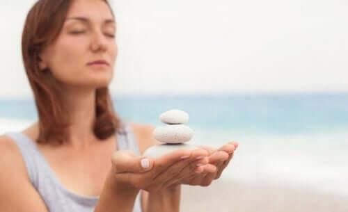 A woman holding white rocks.
