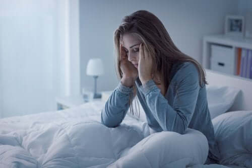 Woman with insomnia disorder in bed.