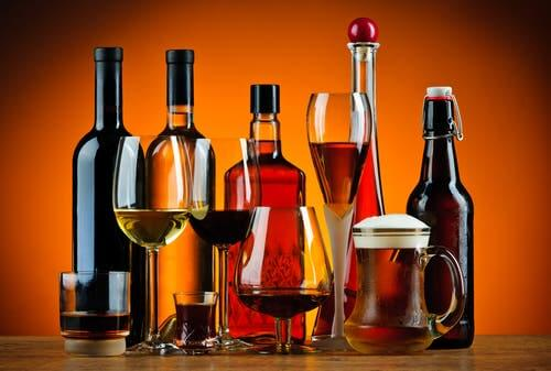 Alcoholic drinks. Drinking a lot can cause high uric acid.