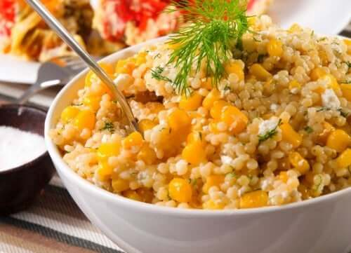 Corn, chives, and quinoa salad in a bowl.
