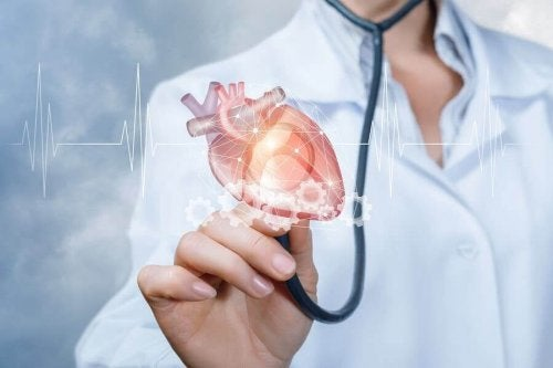 Doctor holding up stethoscope with heart on end.