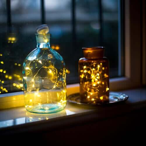Jar lamps by a window, an eco-friendly decoration idea.