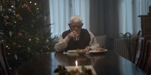 An old man eating alone.