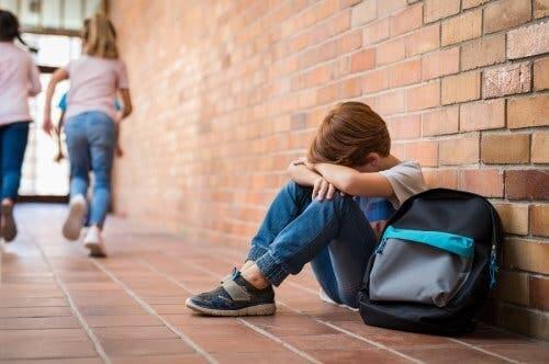 A sad boy in school.