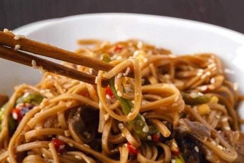 Whole wheat pasta dish with sesame seeds.