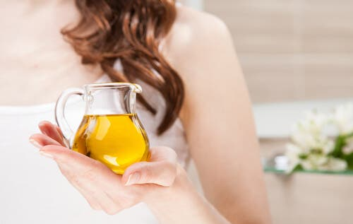 Woman holding a jar of olive oil
