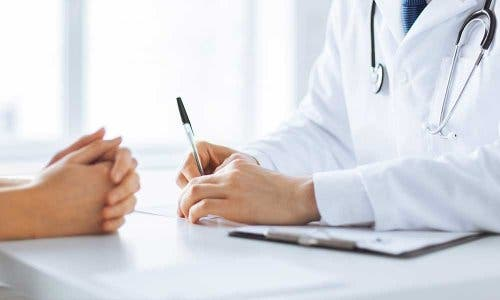 Doctor taking patient's medical history.