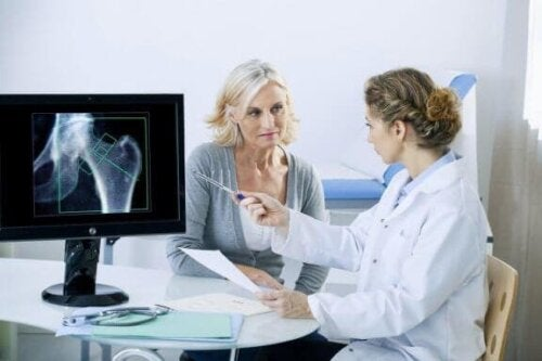 Doctor reviewing hip x-ray with patient with avascular necrosis.