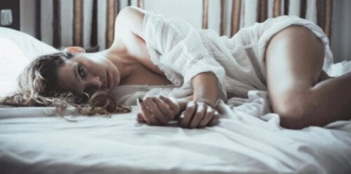 Woman laying on her side in bed.