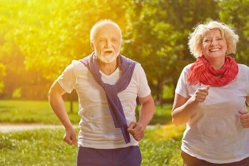 Couple outdoors getting regular physical exercise