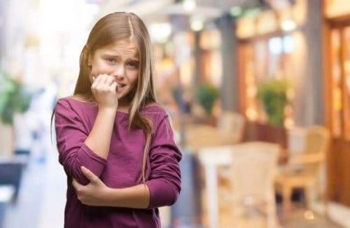 A nervous girl biting her nails.