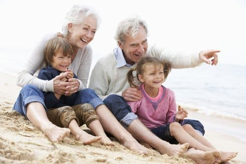 Grandparents on the beach with their grandchildren.