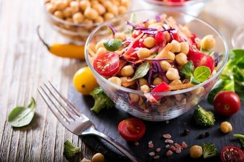 Chickpea and eggplant salad in a clear bowl.